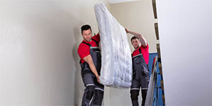 How to carry a heavy mattress upstairs